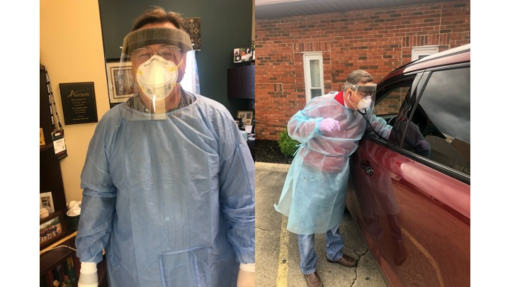 Doctor conducting drive through visit in personal protective equipment